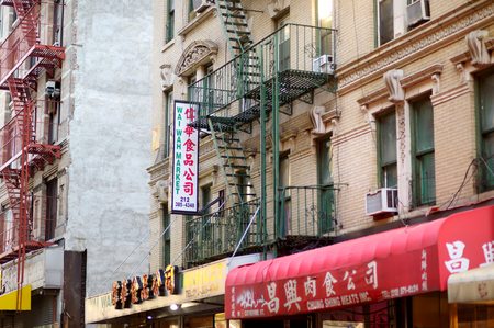 NEW YORK - MARCH 21, 2015: Shop signs of chinese stores in Chinatown district of New York City, one of oldest Chinatowns outside Asia.