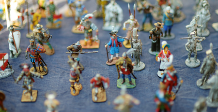 TRAKAI, LITHUANIA - JUNE 16, 2018: Toy tin soldiers sold on market stall during annual Medieval Festival, held in Trakai Peninsular Castle. Recreating medieval town spirit. Editorial