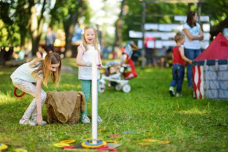 Children playing ring toss game during annual Medieval Festival, held in Trakai Peninsular Castle. Recreating medieval town spirit. Stock fotó - 150639076