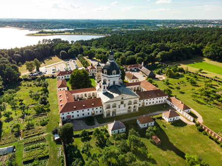 Aerial view of Pazaislis Monastery and Church, the largest monastery complex in Lithuania, located on a peninsula in Kaunas Reservoir. Sunny summer day.