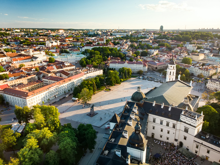 Aerial view of Vilnius Old Town, one of the largest surviving medieval old towns in Northern Europe. Sunset landscape of Old Town of Vilnius, the heartland of the city. Фото со стока