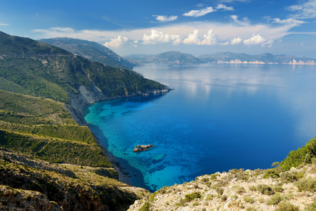Scenic aerial view of picturesque jagged coastline of Kefalonia with clear turquoise waters, surrounded by steep cliffs. Cephalonia, Ionian islands, Greece. Фото со стока