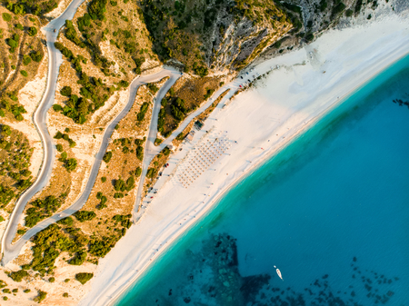 Aerial view of Myrtos beach, the most famous and beautiful beach of Kefalonia, a large coast with turqoise water and white coarse sand, surrounded by steep cliffs. Cephalonia, Greece.