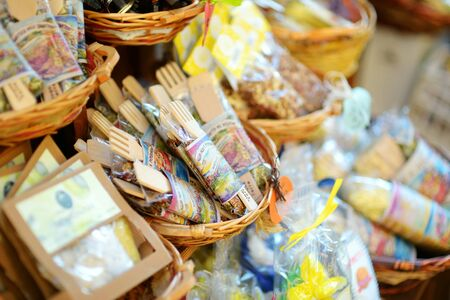 MANAROLA, ITALY - NOVEMBER 18, 2018: Various food, goods and small typical souvenirs sold at small shops at the pedestrian area of Manarola village, Cinque Terre, Liguria. Standard-Bild - 128986444