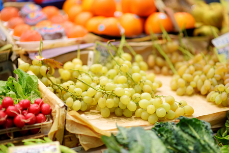 Assorted organic fruits sold on a marketplace in Genoa, Liguria, Italy Stock Photo - 124627375