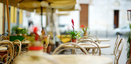 Beautifully decorated small outdoor restaurant tables in the city of Lucca, Tuscany, Italy