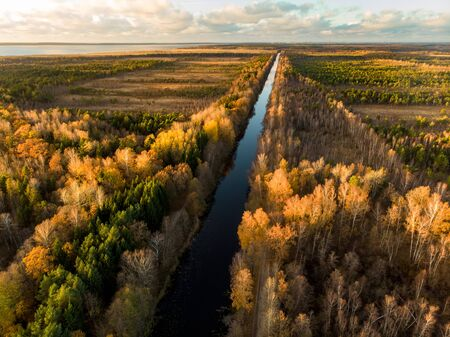 Beautiful autumn aerial view of King Wilhelm's Channel, that connects the river Minija and the Curonian Lagoon. Late autumn bird's eye panorama.