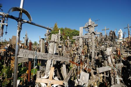 SIAULIAI, LITHUANIA - JULY 30, 2018: Various wooden crosses and crucifixes on the Hill of Crosses, a site of pilgrimage near Siauliai, Lithuania.