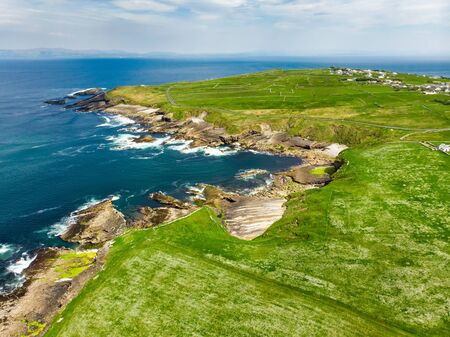 Spectacular aerial view of Mullaghmore Head with huge waves rolling ashore. Picturesque scenery with magnificent Classiebawn Castle. Signature point of the Wild Atlantic Way, County Sligo, Ireland Stock Photo