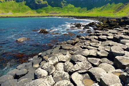 Giants Causeway, an area of hexagonal basalt stones, created by ancient volcanic fissure eruption, County Antrim, Northern Ireland.