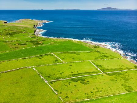 Spectacular aerial view of Mullaghmore Head with huge waves rolling ashore. Picturesque scenery with magnificent Classiebawn Castle. Signature point of the Wild Atlantic Way, County Sligo, Ireland Фото со стока - 128290775