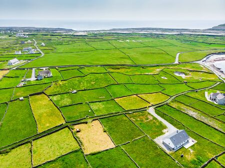 Aerial view of Inishmore or Inis Mor, the largest of the Aran Islands in Galway Bay, Ireland. Famous for its strong Irish culture, loyalty to the Irish language, and a wealth of ancient sites. Standard-Bild - 128291219