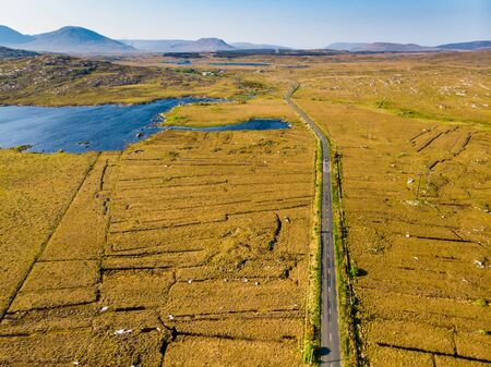 Beautiful aerial sunset view of Connemara region in Ireland. Scenic Irish countryside landscape with magnificent mountains on the horizon, County Galway, Ireland. Standard-Bild - 128291215