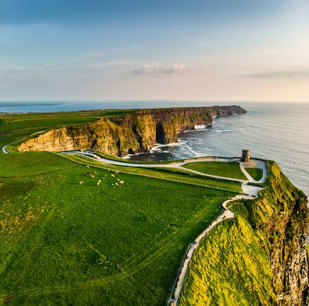 World famous Cliffs of Moher, one of the most popular tourist destinations in Ireland. Aerial view of widely known tourist attraction on Wild Atlantic Way in County Clare. Standard-Bild - 128291217