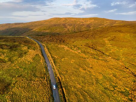 Aerial sunset view of Connemara region in Ireland. Scenic Irish countryside landscape with magnificent mountains on the horizon, County Galway, Ireland. Standard-Bild - 128291252