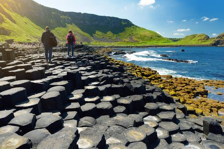 Giants Causeway, an area of hexagonal basalt stones, created by ancient volcanic fissure eruption, County Antrim, Northern Ireland. Standard-Bild - 128291253