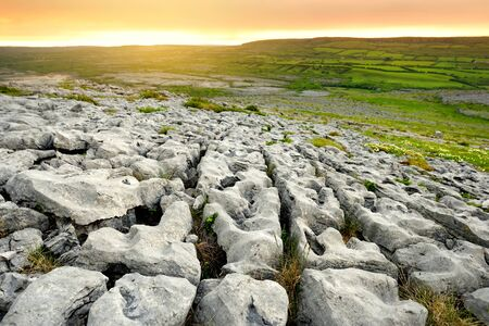Spectacular landscape of the Burren region of County Clare, Ireland. Exposed karst limestone bedrock at the Burren National Park. Rough Irish nature. Standard-Bild - 128291256