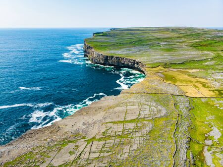 Aerial view of Inishmore or Inis Mor, the largest of the Aran Islands in Galway Bay, Ireland. Famous for its strong Irish culture, loyalty to the Irish language, and a wealth of ancient sites. Standard-Bild - 128291259