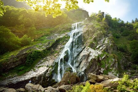 Majestic water cascade of Powerscourt Waterfall, the highest waterfall in Ireland. Famous tourist atractions in co. Wicklow, Ireland. Standard-Bild - 128291264