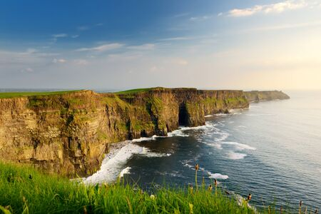 World famous Cliffs of Moher, one of the most popular tourist destinations in Ireland. Beautiful view of widely known tourist attraction on Wild Atlantic Way in County Clare. Standard-Bild - 128291266