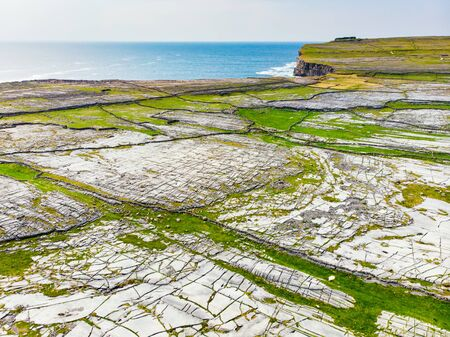 Aerial view of Inishmore or Inis Mor, the largest of the Aran Islands in Galway Bay, Ireland. Famous for its strong Irish culture, loyalty to the Irish language, and a wealth of ancient sites. Standard-Bild - 128291272