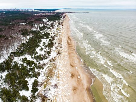 Aerial view of the Baltic Sea shore line near Klaipeda city, Lithuania. Beautiful sea coast on chilly winter day. Winter on Baltic sea.