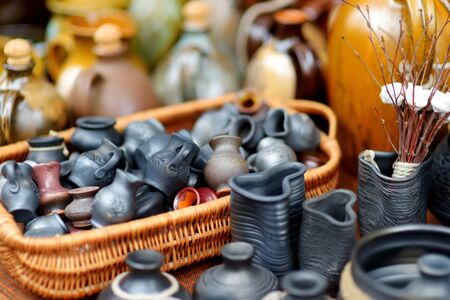 Ceramic dishes, tableware and jugs sold on Easter market in Vilnius. Lithuanian capitals annual traditional crafts fair is held every March on Old Town streets.