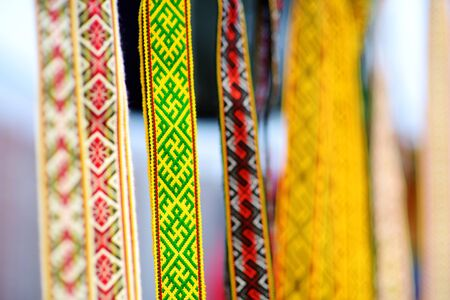 Details of a traditional colorful Lithuanian weave. Woven belts as a part of national Lithuanian costume sold on traditional Easter fair in Vilnius, Lithuania.