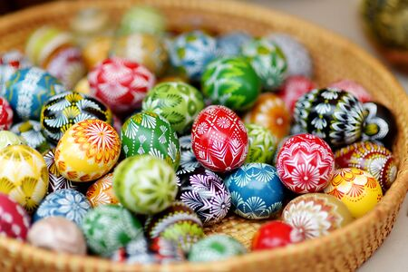 VILNIUS, LITHUANIA - MARCH 4, 2019: Colorful handmade wooden Easter eggs sold in annual traditional crafts fair in Vilnius, Lithuania