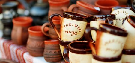 Ceramic dishes, tableware and jugs sold on Easter market in Vilnius. Kaziuko muge means Kaziukas fair in Lithuanian. Annual traditional crafts fair is held every March on Old Town streets.