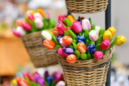 Wooden tulips and decorations sold on Easter market in Vilnius. Annual spring fair hold in March on the streets of capital of Lithuania.
