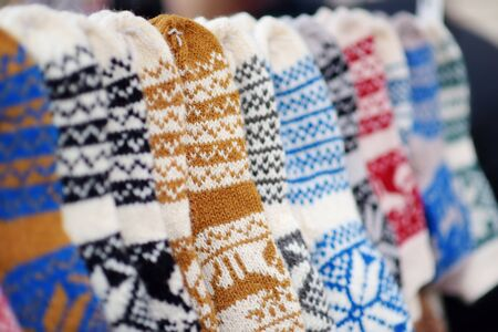 Colorful warm knitted socks sold on Easter market in Vilnius. Annual spring fair hold in March on the streets of capital of Lithuania.