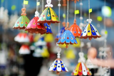 Colorful ceramic bells and other decorations sold on Easter market in Vilnius. Lithuanian capitals annual traditional crafts fair is held every March on Old Town streets.