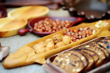 Assorted nuts and organic bread sold on traditional Lithuanian Easter fair in Vilnius, Lithuania