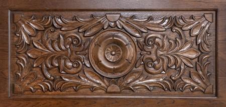 tooled leather: Motivo scolpito su legno, elemento di arredamento