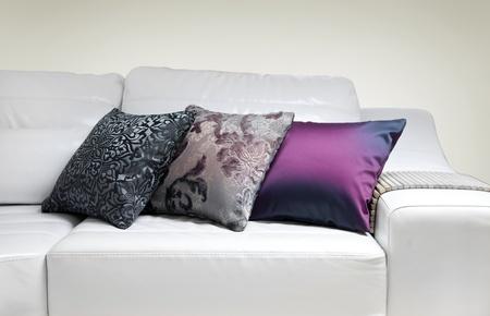 Three decorative pillows on a modern sofa photo
