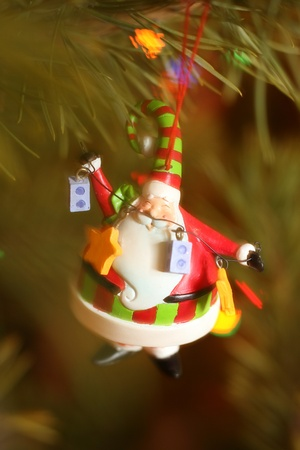 santa claus christmas decoration on tree photo