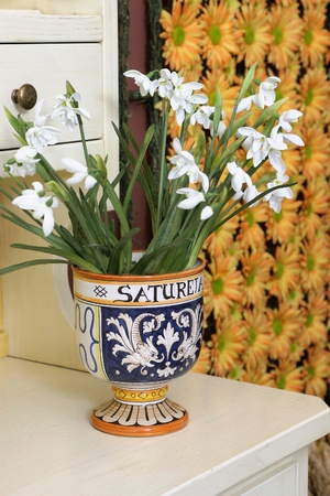 Vase with flowers, country style photo