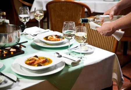 prepared food: Waiter Serving Food