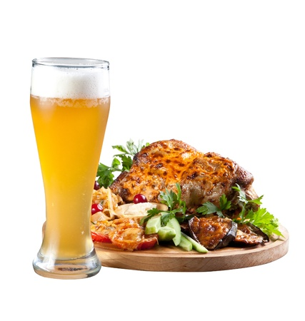 Grilled knuckle of pork with vegetables and beer photo