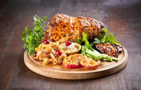 Grilled knuckle of pork with vegetables Stock Photo