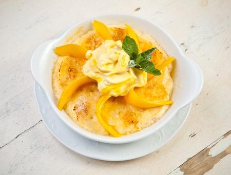 Semolina porridge with mango and whipped cream photo