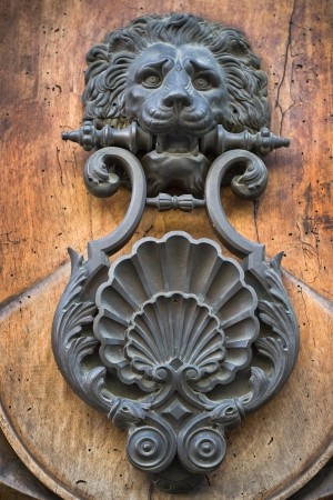 door handles: Old ancient doorknocker, Italia, Rome Stock Photo