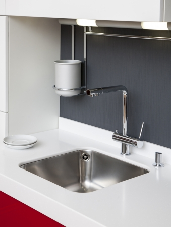 Modern kitchen sink with mixer tap  photo