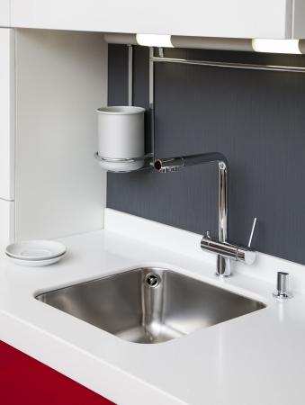 Modern kitchen sink with mixer tap