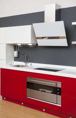 kitchen ware: Modern kitchen interior with red decoration
