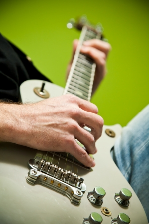 played: Close up of an electric guitar being played.