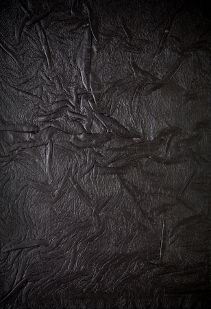 Old leather book cover, crumpled texture photo