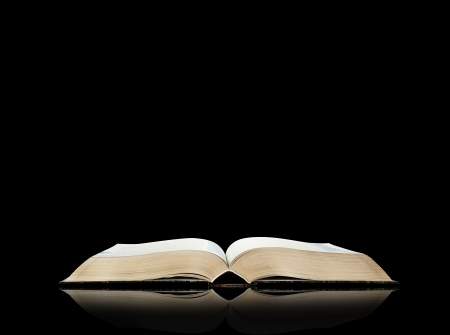 literary: Open book, black background, space for text