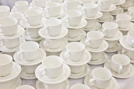 Stacks of coffee cups on saucers